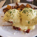 Amazing eggs benedict with roasted tomatoes and asiago.