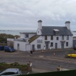 View over the road to the excellent pub and beyond the sandy beach