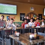Part of the team enjoying the great food and atmosphere.