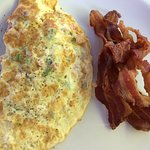 Delicious omelet with extra bacon
