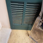 Cheap stained chair holding open roten shutter becasue it would not fasten back in wind.