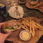 A burger with schnitzel and potato salad