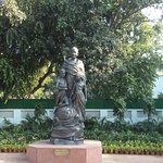 Gandhi statue with boy and girl holding a dove at the main entrance of Gandhi Smriti