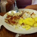 Bisquit , gravy , eggs and hash brown