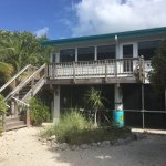 Exterior photos of the bed and breakfast and the beach.