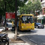 The yellow bus from Danang to Hoi An right in front the Cathedral