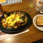 Breakfast skillet with toast and coffee.
