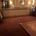 Table removed while we and others are dining. Food debris on floor
