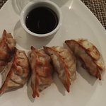 Gyoza, Pork filled dumplings, served with a vinegar-soy sauce and chili oil