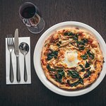 Pizza Fiorentina with a glass of Montepulciano. Perfect at any time.