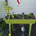 Charming old pump planter graces the front entrance!