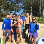 A happy group of first time stand up paddlers.