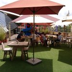 Mambo Italia outdoor terrace with children's playground in the background