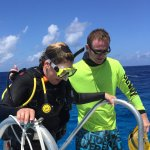 Captain John helps divers out of the water