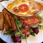 Tasty vegetarian cannelloni with chips and salad