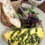 Excellent goat cheese and mushroom pesto omelet and avocado toast with poach eggs