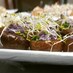 Baby Bella mushrooms stuffed with goat's cheese and topped with sprouts.