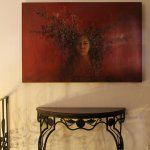 A well curated art collection decorates the rooms and main areas