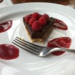 DF/GF chocolate tort with raspberry reduction and cashew crust