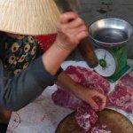 Butcher outside the market