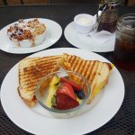 Egg Sammy w fresh fruit, Berry french toast bake w whipped cream and warm syrup