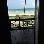 Looking out from the bedroom on to the patio and beach