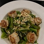 Grilled scallop salad with macadamia nuts.