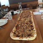 Pizza that is so long it is hard to take a close photo. :)