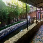 Mosaic walkway to our room with pond
