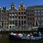 Canal boat cruising along Herengracht (3)