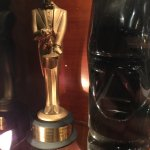 A third award next to the Easter Island head statue
