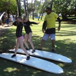Learning how to stand on the board, Meg is aiming at G'ma, headed my way!!!