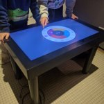 Gaming options on touch screen table. + had 2 similar of these between the coffee bar & restaura