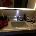 Suite 252. A single sink in a very small area. No towel rod and nowhere to put your stuff. A dec