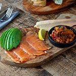 Fish platter with house cured salmon. braised cuttlefish, smoked trout & avocado