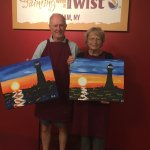 81 year old parents with their paintings
