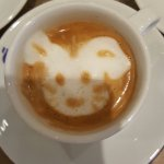 Eve coffee is sreved with a ssmile