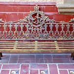 Beautiful antique seating bench in the courtyard.