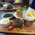 Fillet steak with chips, bernaise sauce and side vegetables