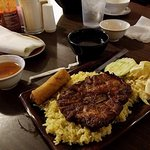 Grilled Pork Steak over fried rice w egg roll,cucumber,lettuce and carrot salad . Very Excellent