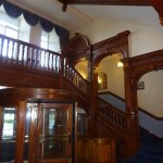 The impressive staircase and revolving front door