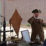 Ben Franklin actor outside during Grand Opening Celebration displaying his inventions