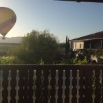 Morning view as hot air balloon drifts by