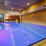 Big heated indoor swimming pool in thePanorama Hotel Garni Buehlerhof in Lana - Italy
