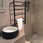 Stylish Moroccan tiled bathroom and laundry at Grace.