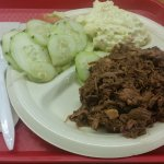 Chopped brisket with potato salad and cucumber salad.