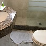 Just how close could the toilet be to the sink? Or how close could the sink be to the shower pan