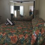 King bed in one bedroom with closets, dressers, and additional tv