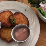 potato pancakes with sour cream and applesauce; cucumber and dill salad
