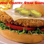 with jalapeno slices, pepper jack cheese, lettuce tomatoes, and boom boom sauce
